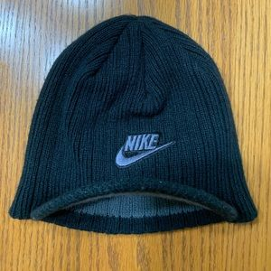Nike beanie with small bill. Black in color.